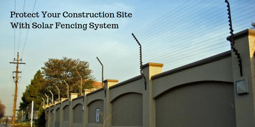 construction site with solar fencing system